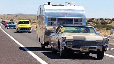 A line of Fun Run participants heads down Route 66 Saturday toward Kingman. (ALAN CHOATE/Miner)<br /><br /><!-- 1upcrlf2 -->