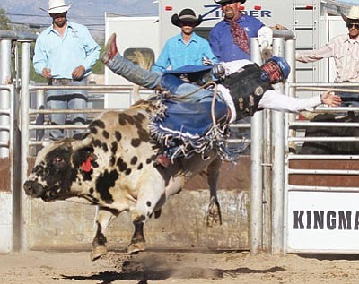 Bullrider Will Rogers is shown during last September's Andy Devine Days Rodeo at the Mohave County Fairgrounds. (JC AMBERLYN/Miner)