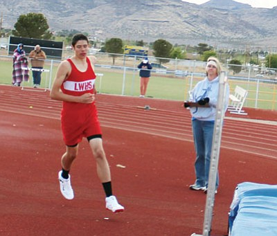 SHAWN BYRNE/Miner<BR> State champion Giancarlo Narvarte approaches the bar during an attempt April 2 at Kingman High. The Lee Williams sophomore captured the Division III title in the event Friday at Mesa Community College by clearing 6-6 on his first attempt.