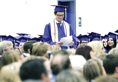 Kingman Academy High School presented its graduating class of 2014 at the school's Betty Rowe Gymnasium Wednesday. Here,  Gabriel El-Awik stands to give a Valedictorian speech. (JC AMBERLYN/Miner)