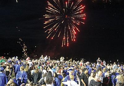 Fireworks helped Kingman High send off its 2014 graduates Thursday. (JC AMBERLYN/Miner)