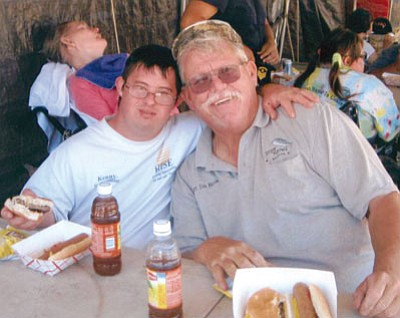 Courtesy<BR> Don Martin and a special friend share lunch at Fishing For Smiles.