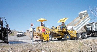 MARVIN ROBERTSON/Miner Photo<BR>Kingman Streets Department chip sealing was on Ft. Beale trail Monday after a busy Sunday on Stockton Hill Road.  Photo taken in May 2003.