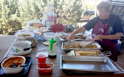 Courtesy<BR> Sue Newt shows some of the food at the Meadview Baptist Church cookout on May 31.