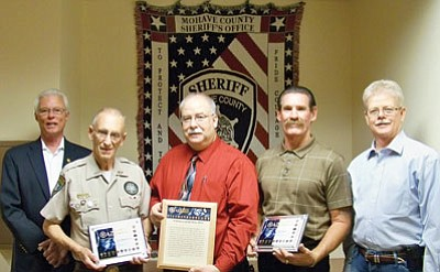 Courtesy<BR>From the left are Chief Deputy Jim McCabe, Posse member and award recipient Tom Henderson, Mohave County Adult Detention Facility Commander Don Bischoff, Chaplain and award recipient Mike Querio, and Sheriff Tom Sheahan.