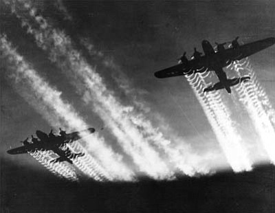 Two B-17 Flying Fortresses leave vapor trails while flying over Eastern Europe. (USAF/Courtesy)