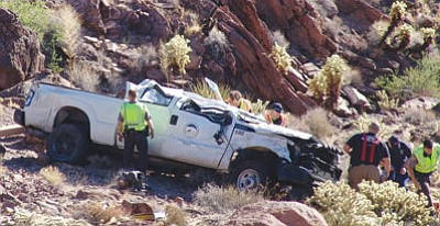 Firefighters prepare to extricate Mohave County Public Works supervisor Kevin Stockbridge, whose truck ran off a cliff Wednesday morning. (Courtesy)