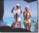 Courtesy Photo Patrick and Lisa McVey pose on their boat with lobsters they caught in the Bahamas.