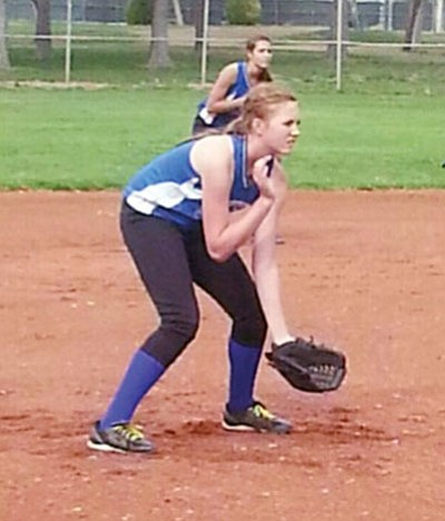Courtesy<BR> Aspen Jackson gets in the ready position at third base for the Kingman Academy Middle School Coyotes. Jackson is expected to a key player at Kingman Academy High in volleyball, basketball and softball.