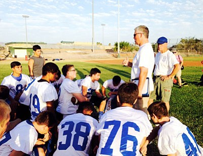 Courtesy/Vicki Trujillo<BR> The Kingman High Bulldogs football team listens to direction given by newly named head coach Greg Tonjes (wearing sunglasses) during June 10's 7-on-7 competition at Mohave High School in Bullhead City. Tonjes was named to replace David Ward as head coach for the Bulldogs last week. Ward left due to family medical issues.