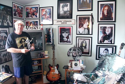 JC AMBERLYN/Miner<BR> Scott Wilfong with his extensive Beatles collection inside his home Thursday.