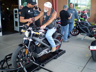 HUBBLE RAY SMITH/Miner<BR> Rick Patton of Kingman takes a stationary spin on Project LiveWire, the first electric motorcycle from Harley-Davidson, during a West Coast tour that stopped Wednesday at Kingman's Mother Road Harley-Davidson dealership.