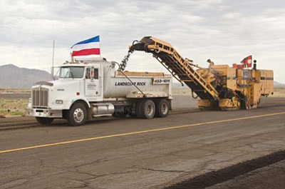 McCormick Construction of Bullhead City has commenced work on the $1.1 million resurfacing of taxiway D at Kingman Airport. The project is expected to be completed by Aug. 12. (Courtesy)