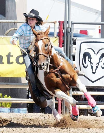 Courtesy<BR> Breezy Weber gets around a barrel during a competition this year.