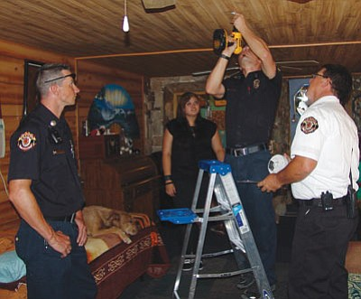 Pictured from left are Engineer Luke Weber, Debra Eaton's daughter Destinee, firefighter Robert Cole and Assistant Chief Jack Yeager. They're installing one of three smoke alarms. (GVFD/Courtesy)