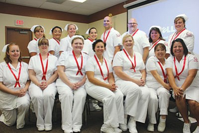 Courtesy<BR> Mohave Community College awarded professional pins to 15 students who completed the college's practical nursing program.