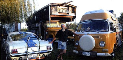 Bob Waldmire next to his 1972 Volkswagen Microbus. (Courtesy)