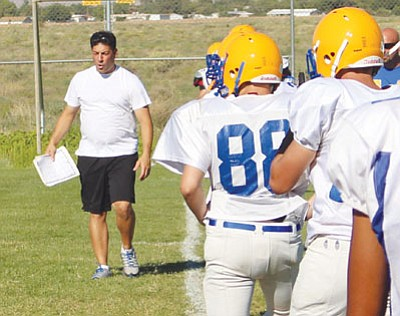 SHAWN BYRNE/Miner<BR> Ex-KHS assistant football coach Mike Pagliaro walks the line of scrimmage during his last practice with the Bulldogs on Friday.