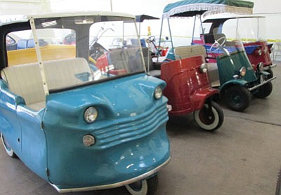 Electric micro cars from the 1960s. (KIM STEELE/Miner)