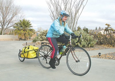 Michelle Thompson is pictured on her bicycle in Kingman in December 2006 before heading to Oatman. She was taking a 2,400-mile bicycle ride along Route 66 from Chicago to Costa Mesa, Calif., to raise awareness about oral cancer and to help out her brother financially.  (JC AMBERLYN/Miner)