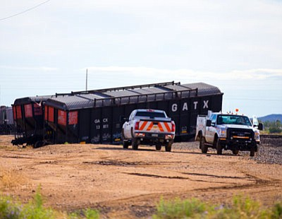 These two BNSF cars came to a stop off the tracks after derailing near the Kingman Airport Thursday afternoon. (PHIL DURRETT/Courtesy)
