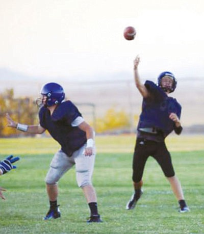 Courtesy/KAHS ATHLETICS<BR> Academy quarterback Will Herbine lets fly a pass at Saturday's scrimmage in Needles, Calif.