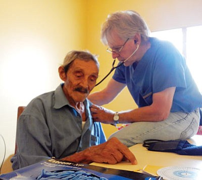 A 94-year-old man gets a checkup from Kingman's Dr. Ken Jackson, who traveled to rural Honduras as part of a team that treated residents. (Courtesy)