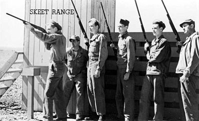 A solider takes aim with a shotgun at the former skeet range outside of Kingman. This was part of their training during World War II. (Mohave Museum of History and Arts/Courtesy)<br /><br /><!-- 1upcrlf2 -->