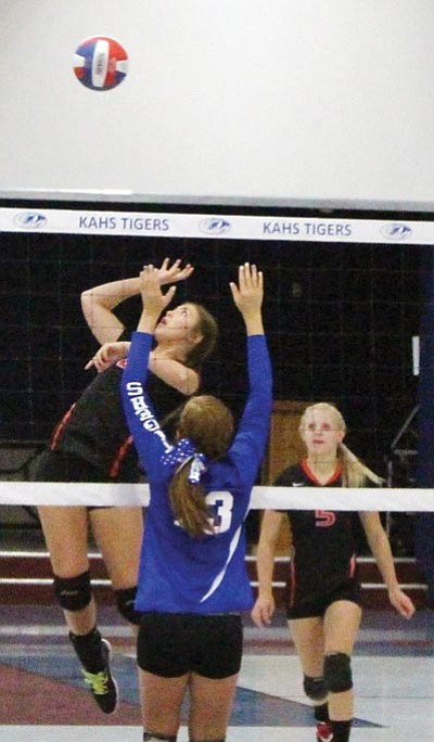 SHAWN BYRNE/Miner<BR> LWHS' Marli Lauch goes over KAHS' Abbie Boss.