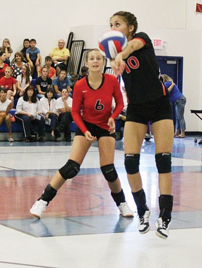 SHAWN BYRNE/Miner<BR> Lee Williams' Madi Arave returns a serve as Tori Hummel looks on during the Sept. 11 match at Kingman Academy. Arave was 14-for-15 in digs during Tuesday's four-set loss to Havasu.