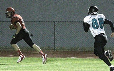 Lee Williams' Landon Kramer finds himself all alone for a 35-yard touchdown reception during the Volunteers' 62-0 Homecoming Game win over Grehyhills Friday at LWHS.