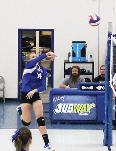 Kingman Academy's Aspen Jackson executes a kill-shot during the Lady Tigers win Thursday. Jackson led KAHS with 14 kills.
