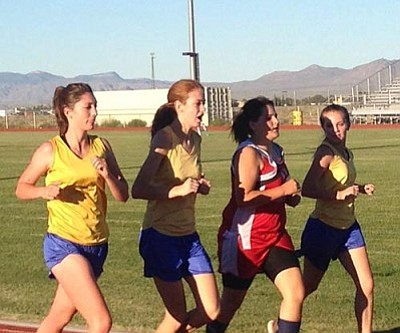 Courtesy/Anne Bathauer<br /><br /><!-- 1upcrlf2 -->From left in gold, Kingman's Brianna Gastineau, Megan Gaul and Jessica Baca lead Kristina Amantract, red, around the track to the finish line Wednesday.