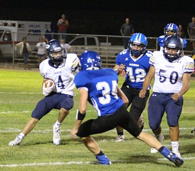 ALAN CHOATE/Miner<BR> Kingman Academy had a hard time defending the run Friday night.