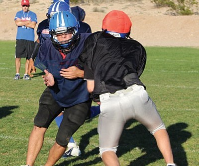 SHAWN BYRNE/Miner<br /><br /><!-- 1upcrlf2 -->Academy's Chy Banda, left, puts his shoulder into a block during Wednesday's practice at Southside Park.