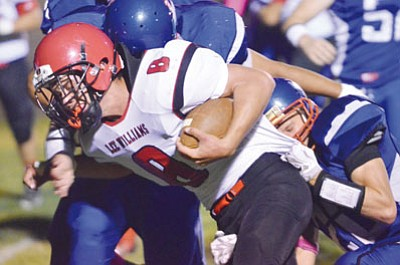 VYTO STARINSKAS PHOTOS<BR> Lee Williams' Dallas Morgan pushes forward for some of his 146 yards rushing  in the Vols' 27-0 win Friday at Camp Verde.