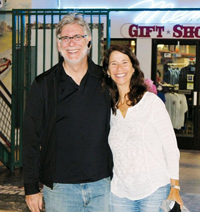 Bob Marrazzo and Michele Levin of Palm Harbor, Fla., were welcomed Wednesday as the 100,000th visitor to the Kingman Powerhouse Museum and Visitor Center. (Courtesy)<br /><br /><!-- 1upcrlf2 -->