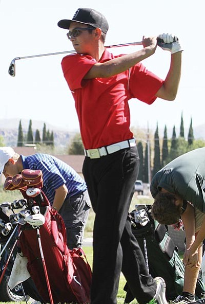JC AMBERLYN/Miner<BR> Lee Williams' Richard Serrano hits a shot during Friday's Kingman Invitational at Cerbat Cliffs Golf Course. Serrano finished second in the event, two strokes behind teammate Brandon Carver.