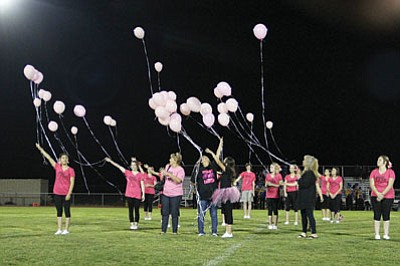 Kingman High cheerleaders and cancer survivors release balloons during halftime of Friday�s game against Paradise Valley,  one of any number of events held in October to honor those who have battled breast cancer and other forms of cancer. (JC AMBERLYN/Miner)<br /><br /><!-- 1upcrlf2 -->