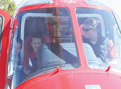 Tristate CareFlight had an Agusta 119 Koala helicopter on site for kids to climb into at last year's Young Eagles event. Tristate CareFlight flight paramedic Kory Guillet speaks to Kane, 4 (left) and Taelon, 6, Thomason.