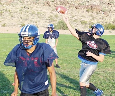 SHAWN BYRNE/Miner<br /><br /><!-- 1upcrlf2 -->Freshman quarterback Kannon Butler makes a throw at practice Wednesday as Jonathan Seybert pass protects. Butler gets the start at Greyhills today.