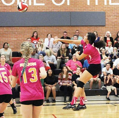 JC AMBERLYN/Miner<BR> Kingman's Desirae Gonzalez attempts a back-row kill during Thursday's match at Lee Wiliams.
