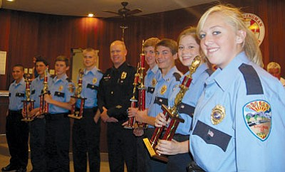 DOUG McMURDO/Miner<BR>Members of the Kingman Police Department's Explorer Post 47 stand with the trophies they won at the 2014 Southern Arizona Law Enforcement Explorer Competition held earlier this month in Marana. They are, from the left, Joshua Barroga, Nick Ortiz, Lt. John Smith, Cayden McLeod, KPD Officer Denny Gaddis, Lt. Lane Brock, Capt. David C. Snelling, Lindsey McDermott and Kerissa Salmon.