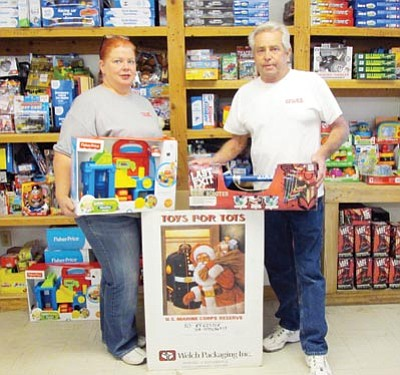 KIM STEELE/Miner<BR> From left, Casey Farrell and Don Olin display some of the toys already collected for the annual Toys for Tots campaign this year and the boxes that will soon be set out at retail locations throughout the area.