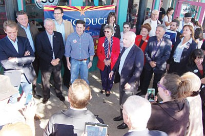 DOUG McMURDO/Miner<BR> Sen. John McCain, center, spoke on behalf of Republican candidate for governor Doug Ducey, third from left, and other candidates at Mr. D'z Diner in Kingman on Monday afternoon. Sen. Jeff Flake, far left, was also on hand, as were, District 5 state Rep. Sonny Borrelli and Dr. Gina Cobb, a candidate for the district's second seat, far right. U.S. Rep. Paul Gosar, state Sen. Kelli Ward, R-Lake Havasu, and Secretary of State candidate Michele Reagan also attended the spirited gathering that was attended by dozens.