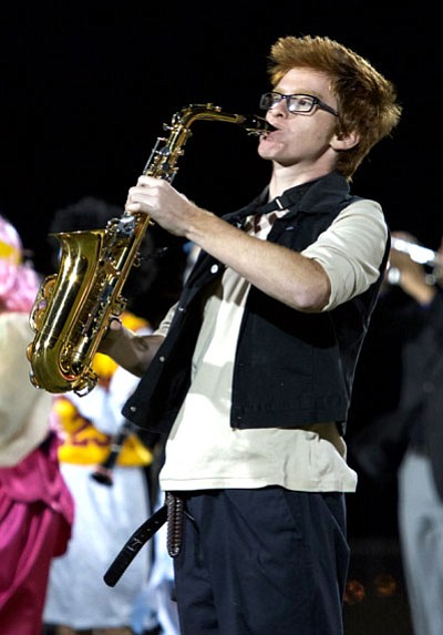 RYAN ABELLA/Miner<BR> Sean McMullen of KHS flares his alto saxophone during the halftime performance of the Mohave-Kingman High football game on Halloween.