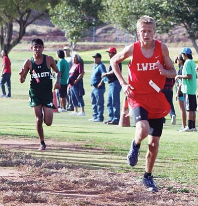 Courtesy<BR> Lee Williams' Brendon Allred keeps his distance from Tuba City's Albert Fuller during the AIA D-III, Section I championship race last Friday. Allred placed 12th and runs in Saturday's D-III state championships.