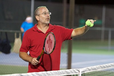 RYAN ABELLA/Miner<BR> Robert Pacinelli offers advice to his students during tennis lessons at Centennial Park.