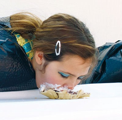 RYAN ABELLA/Miner<BR> Mikayla Wygal competes in the Pie Eating Contest at the Kingman Fall Festival in Centennial Park Oct. 25.