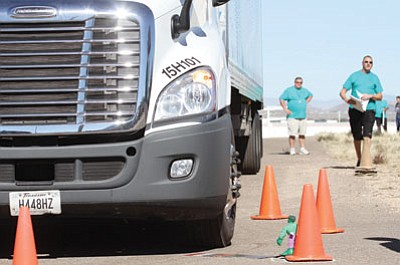 JC AMBERLYN/Miner<BR> A judge runs alongside a McKee Food Corp. truck as its front driver-side tire touches a marker in the sand without coming close enough to hit the small Hulk action figure leaning against an orange cone.